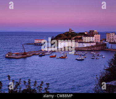 Tenby Harbour and old lifeboat station with boats in harbour at sunset at full tide. - Stock Photo