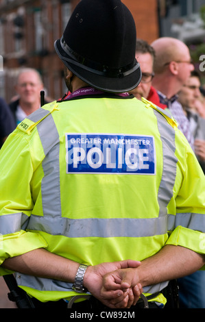 A Greater Manchester police officer on crowd duty at a football match in England, UK - Stock Photo