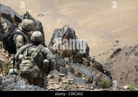 U.S. Army soldiers search mountains in the Andar province of Afghanistan for Taliban and weapons caches. June 6 - Stock Photo