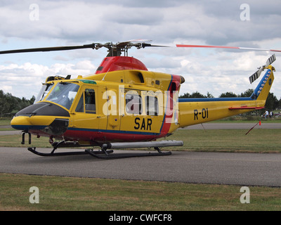 Dutch SAR search and rescue helicopter Agusta Bell 412 SP side view at Seppe airfield, the Netherlands - Stock Photo