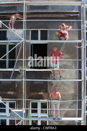 Geruestbauer on a scaffold, Posen (Poznan), Poland - Stock Photo