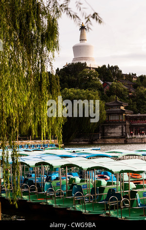 View at sunset of the White Dagoba Tibetan style stupa in Beihai Park in Beijing, China - Stock Photo