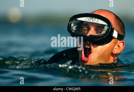 An Air Force Pararescue Jumper trainee swims to the finish point August 17, 2011 at Calaveras Lake, Texas. During - Stock Photo