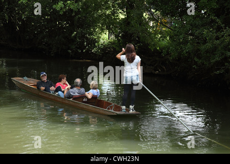 A family punting on the Thames in Oxford UK. - Stock Photo