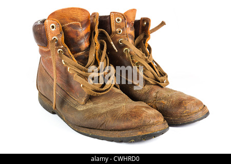 Pair of old worn brown leather work boots on white - Stock Photo
