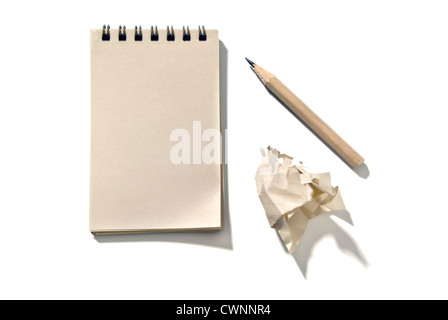 Notepad with a pencil and a piece of crumpled paper, isolated on 100% white background - Stock Photo