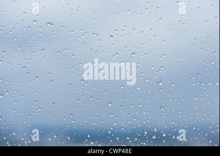 Raindrops on window, close-up - Stock Photo