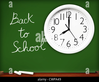 Back to school concept, handwriting on a green chalkboard with big white clock.... - Stock Photo