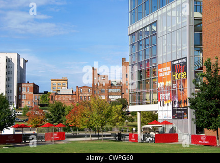 Durham, North Carolina, NC. Durham Performing Arts Center in the foreground overlooking old brick buildings in downtown. - Stock Photo