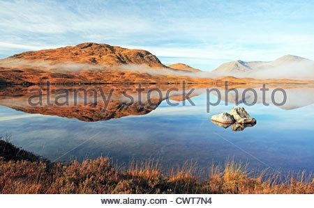 Scottish mountain reflection on Loch - Stock Photo