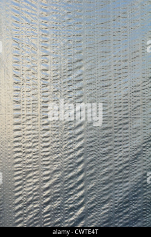Gray polyethylene film's background. High resolution texture - Stock Photo
