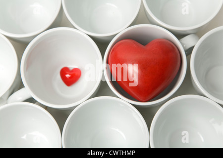 Small and large heart with coffee cups - Stock Photo