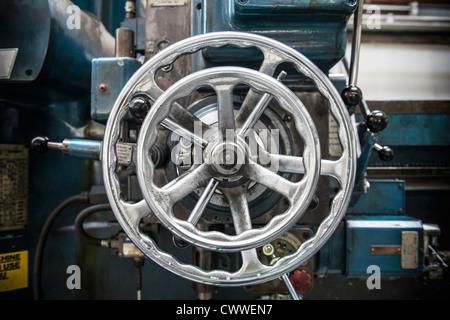 Wheel on lathe in car factory - Stock Photo