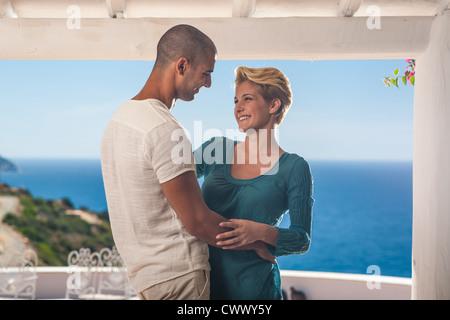 Couple dancing together on balcony - Stock Photo