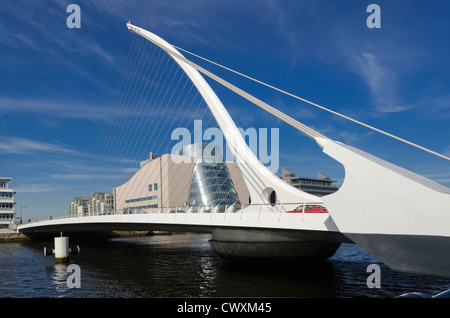 Samuel Beckett Bridge over the river Liffey, Dublin with new Convention Centre in the background, Ireland - Stock Photo