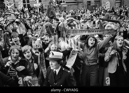 Bay City Rollers pop group boy band fans Newcastle UK 1970s, The Rollers have just arrived at the concert hall. - Stock Photo