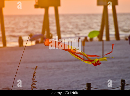 windchime on a beach scene at sunset - Stock Photo