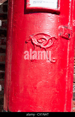 Close up of an old post box from Victorian times with insignia VR for Victoria Regina - Stock Photo