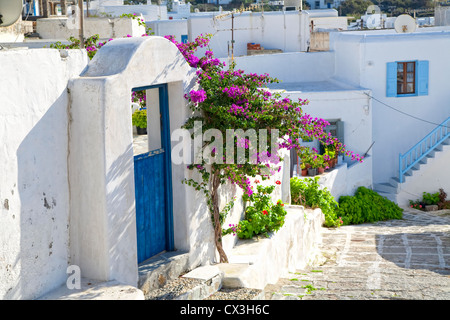 A winding road through a small town on the island of Mykonos, Greece. - Stock Photo