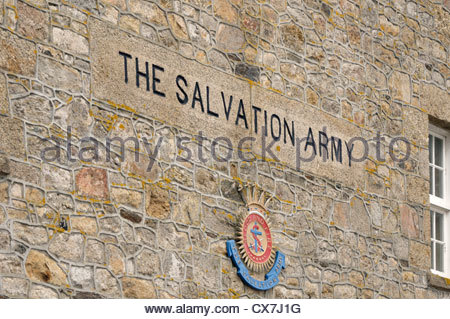 The Salvation Army sign carved in stone in a wall with badge underneath, Wharf Road, St Ives, Cornwall, England - Stock Photo