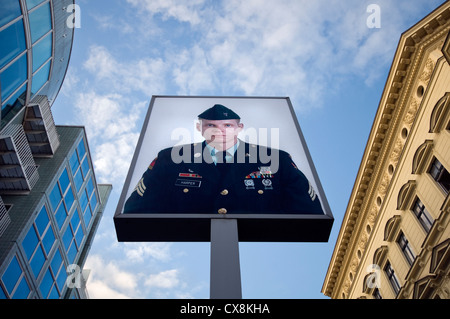 Portrait of American soldier Jeff Harper at Checkpoint Charlie in Berlin, Germany - Stock Photo