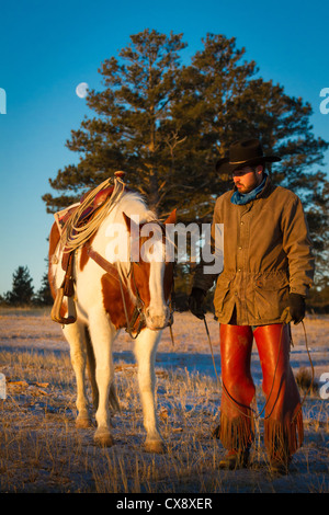 Cowboy on his horse on a ranch in northeastern Wyoming - Stock Photo