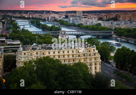 The river Seine and some of the many bridges that crosses it as it snakes its way through Paris, France - Stock Photo