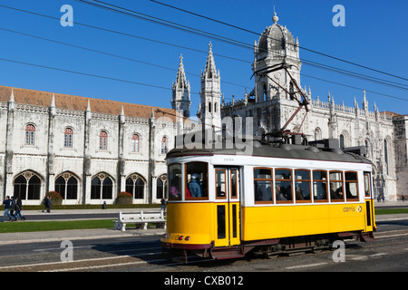 Mosteiro dos Jeronimos, UNESCO World Heritage Site, and tram (electricos), Belem, Lisbon, Portugal, Europe - Stock Photo