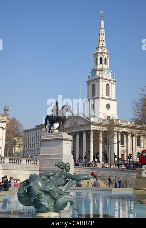 Trafalgar Square fountains and St. Martin in the Fields, London, England, United Kingdom, Europe - Stock Photo
