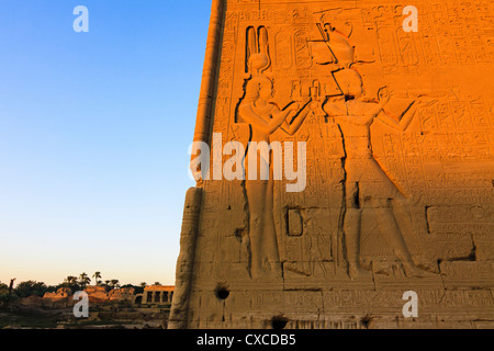 Reliefs of Cleopatra VII and Caesarion, her son with Julius Caesar, at the Temple of Hathor at Dendera. Egypt. - Stock Photo