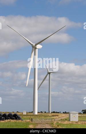 2 giant wind turbines (eyesore?) tower over farmland fields in scenic countryside - Knabs Ridge onshore wind farm, - Stock Photo