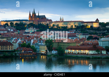 St. Vitus Cathedral, River Vltava and the Castle District illuminated in the evening, Prague, Czech Republic - Stock Photo