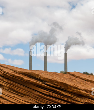 Red rocks and smoking pipes - Stock Photo