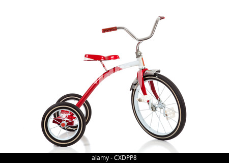 A red vintage tricycle on a white background - Stock Photo