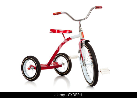 A red tricycle on a white background - Stock Photo