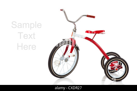 A red tricycle on a white background with copy space - Stock Photo
