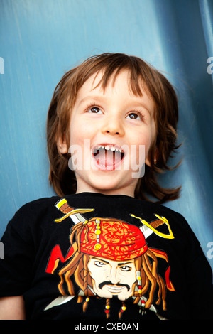 Young boy coming down a slide - Stock Photo