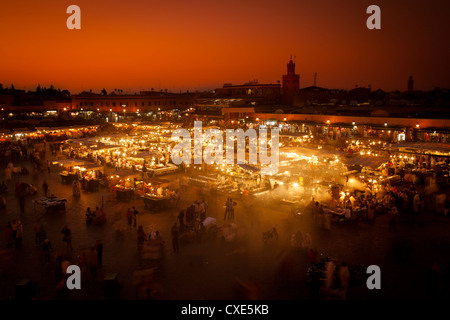 View at sunset across Djemaa El Fna, Marrakech, Morocco, North Africa, Africa - Stock Photo