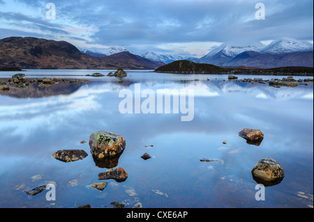 Snow covered mountains at dawn, Lochan na h Achlaise, Rannoch Moor, Argyll and Bute, Highlands, Scotland - Stock Photo