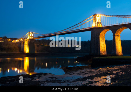 Menai Bridge illuminated at dusk, Gwynedd, Anglesey, North Wales, Wales, United Kingdom, Europe - Stock Photo