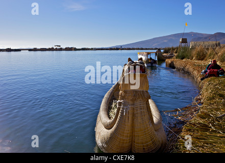 Floating islands of the Uros people, traditional reed boats and reed houses, Lake Titicaca, peru, peruvian, South - Stock Photo