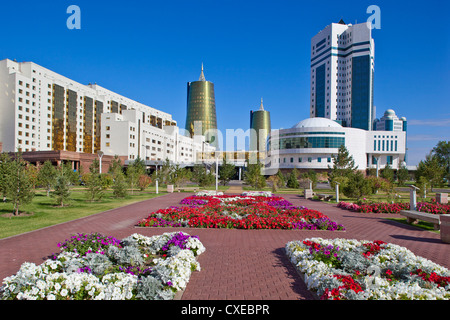 House of Ministries and twin golden conical business centres, Astana, Kazakhstan - Stock Photo
