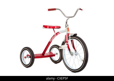 Red vintage tricycle on a white background - Stock Photo