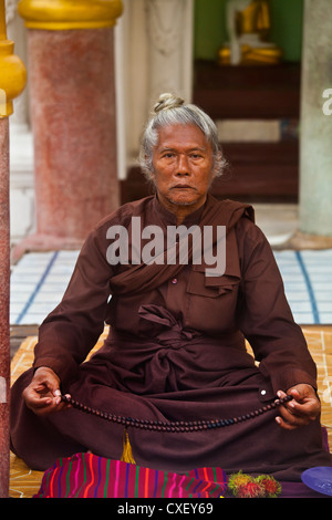 A HOLY MAN at the SHWEDAGON PAYA or PAGODA which dates from 1485 - YANGON, MYANAMAR - Stock Photo
