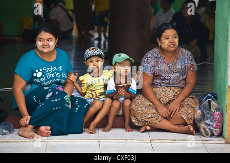 BURMESE WOMEN with their sons at the SHWEDAGON PAYA or PAGODA which dates from 1485 - YANGON, MYANAMAR - Stock Photo