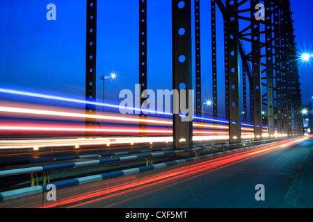 light trails on the steel bridge - Stock Photo
