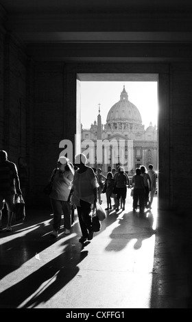 tourists framed in front St Peters Basilica, Vatican, Rome. - Stock Photo