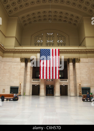 Interior View Of Union Station, Chicago, With Large Stars And Stripes Flag - Stock Photo