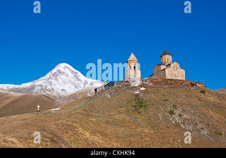 Mount Kazbek and Trinity Monastery, Georgia - Stock Photo