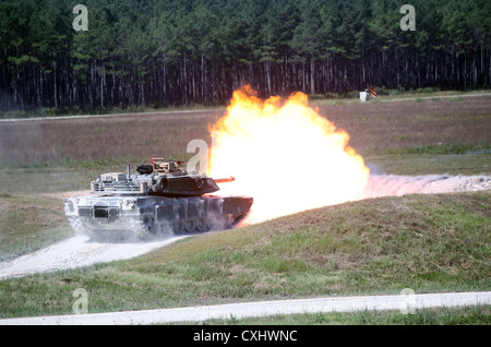 An M1A1 Main Battle Tank fires from its main gun Sept. 26 during a practice shoot for the 2012 Tiger Competition - Stock Photo